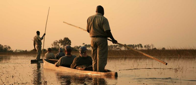 africa-botswana-okavango-delta-traditional-mokoro-at-sunset
