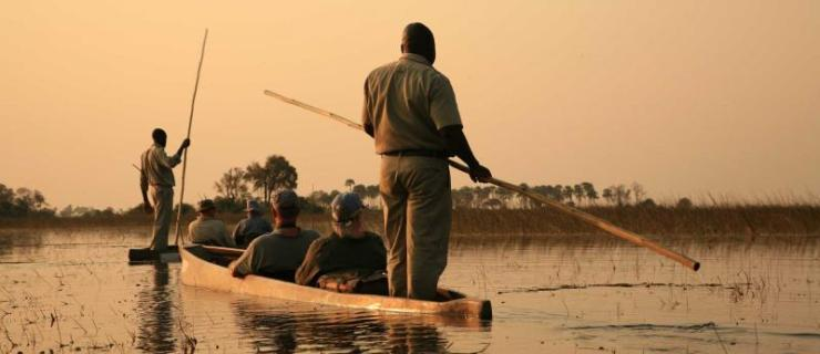 africa-botswana-okavango-delta-traditional-mokoro-at-sunset