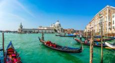 beautiful_view_of_traditional_gondola_on_canal_grande_with_historic_basilica_di_santa_maria_della_salute_in_the_background_on_a_sunny_day_in_venice_italy_0