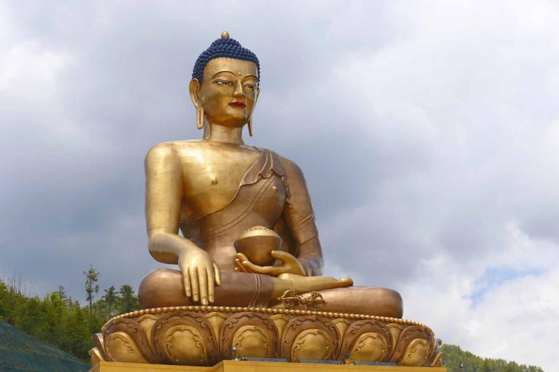 bhutan_thimphu_buddha_dordenma_statue_against_sky_background