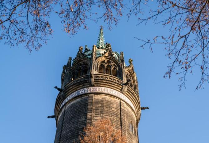 germany_the_spire_where_martin_luther_nailed_the_ninety-five_theses_on_the_door_and_sparked_the_reformation_in_wittenberg_germany_on_december_2_2016_0
