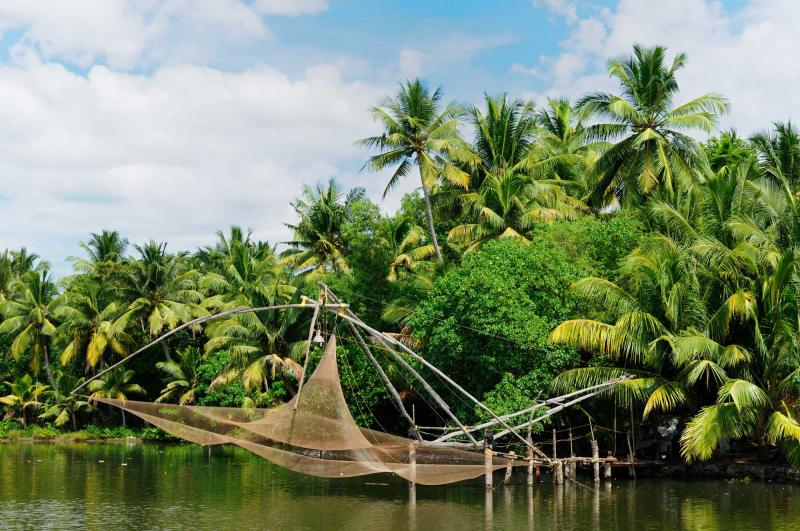 india_coco_trees_reflection_and_chinese_fishing_nets_at_back_waters_of_kerala