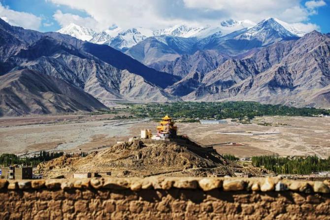 india_delhi_golden_roof_monastery_and_snow_mountain_range_leh_ladakh