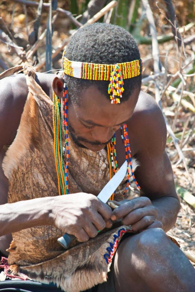 tanzania_lake_eyasi_tour_hadza_man_building_an_arrow_-_editorial_use_only