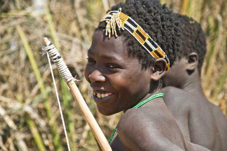 tanzania_lake_eyasi_tour_young_hunter_from_hadza_tribe_with_his_bow_-_editorial_use_only_1