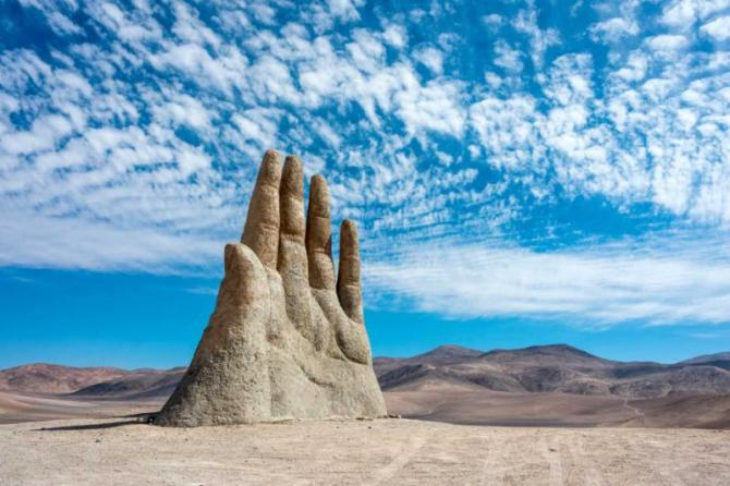 antofagasta_april_6_rains_in_the_atacama_desert_washed_away_graffiti_from_the_sculpture_hand_of_desert_mano_de_desierto_april_6_2014_in_the_atacama_desert_near_antofagasta_chile