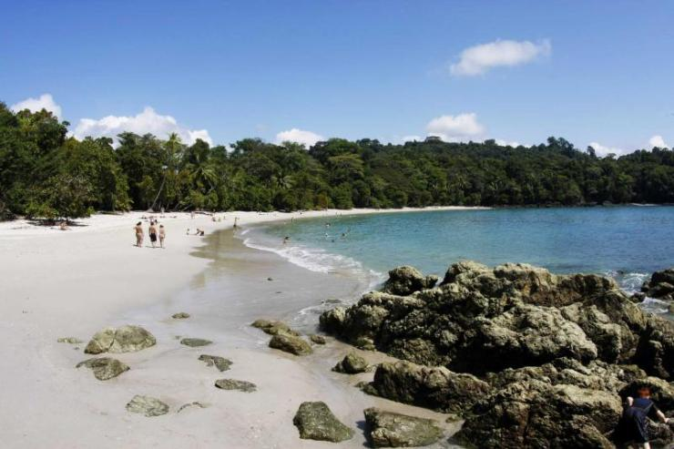 costa-rica-manuel-antonio-national-park-beach-with-some-bathers-full_1