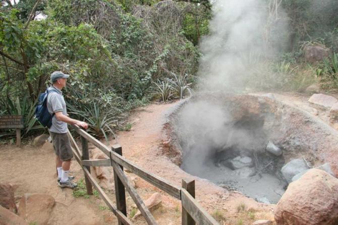 costa_rica_rincon_de_la_vieja_tour_hiker_viewing_boiling_mud_pot