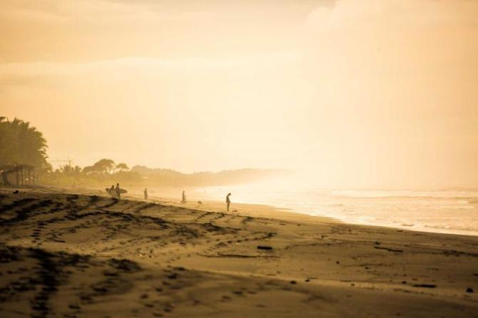 costa_rica_surfers_in_the_dawn_at_playa_jaco