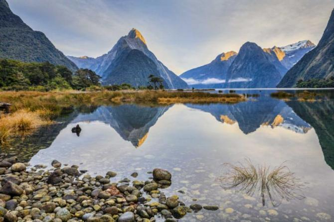 first_light_on_mitre_peak_and_surrounding_mountains_at_milford_sound_fiordland_in_new_zealand39s_south_island